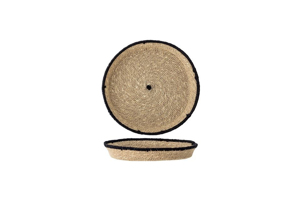Sein kreisförmiges Muster wird durch einen schwarzen Rand und eine schwarze Mitte hervorgehoben