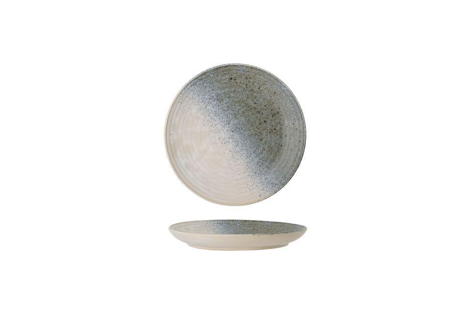 Dieser Teller aus Steingut wird Sie mit seiner originellen und undefinierbaren Farbe mit