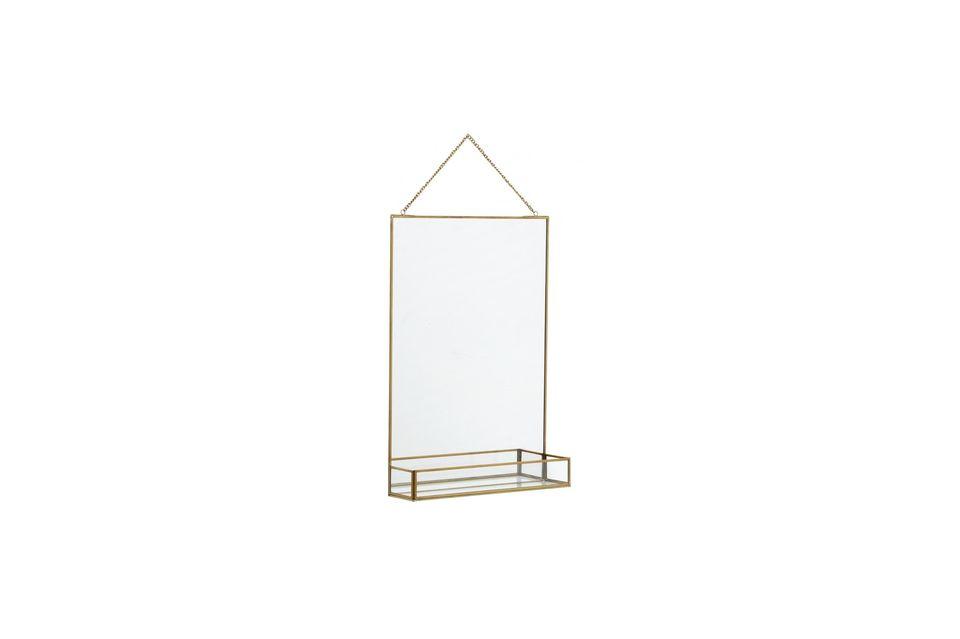 Ein Spiegel und sein Regal, hervorgehoben durch eine Goldoberfläche